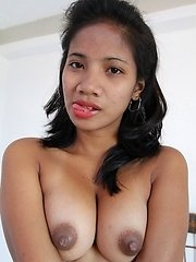Pinay with big brown nipples poses for pussy hounds camera